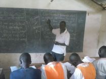 Headmaster teaching Maths